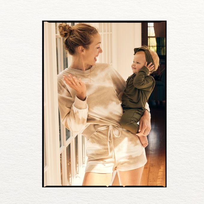 Women in comfortable sweat suit with baby.