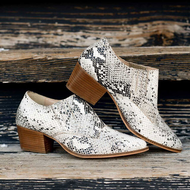 Snake skin booties with an almond and ankle height.