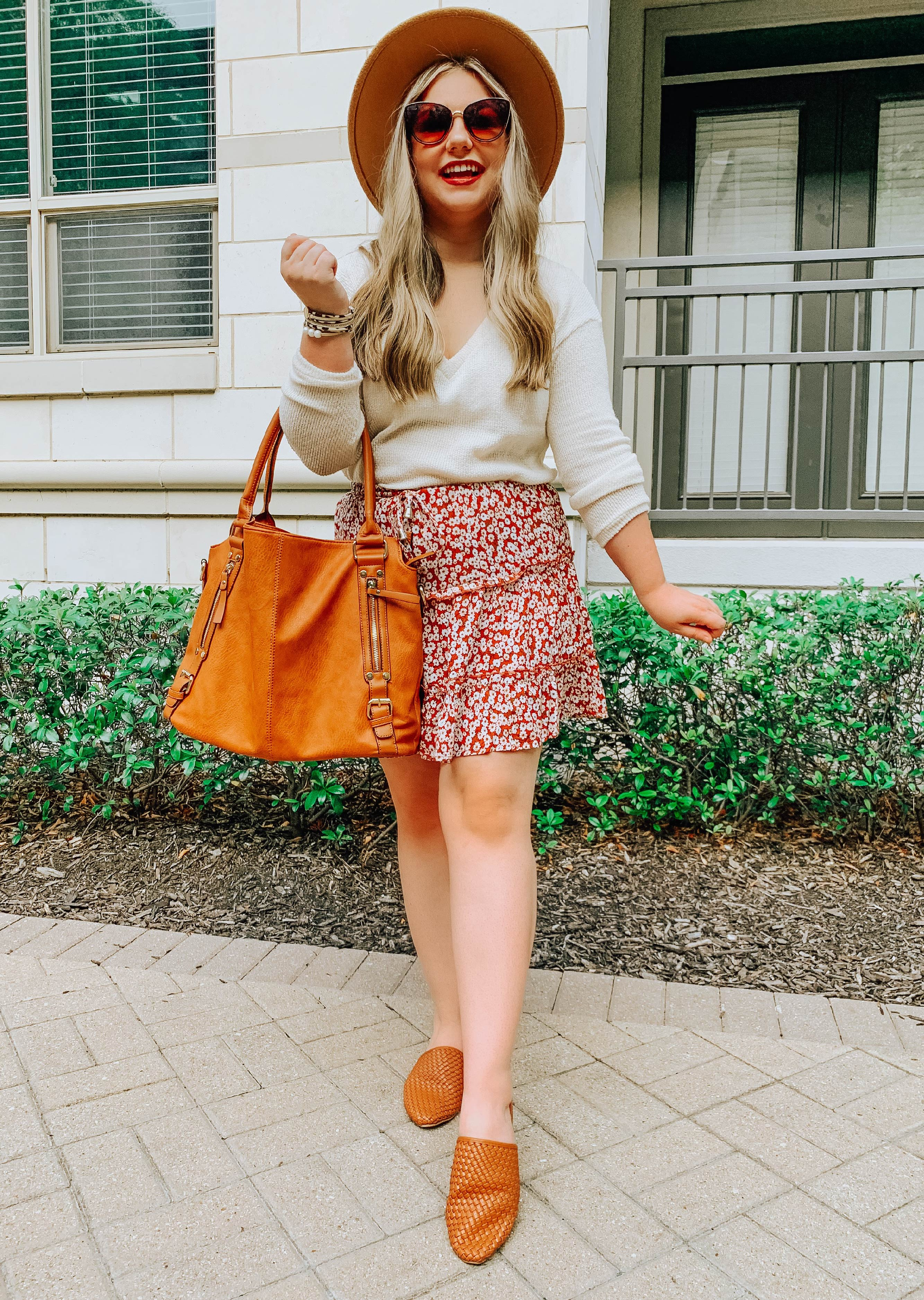 Look 1 - Cream Sweater with floral skirt, brimmed hat, and large purse.
