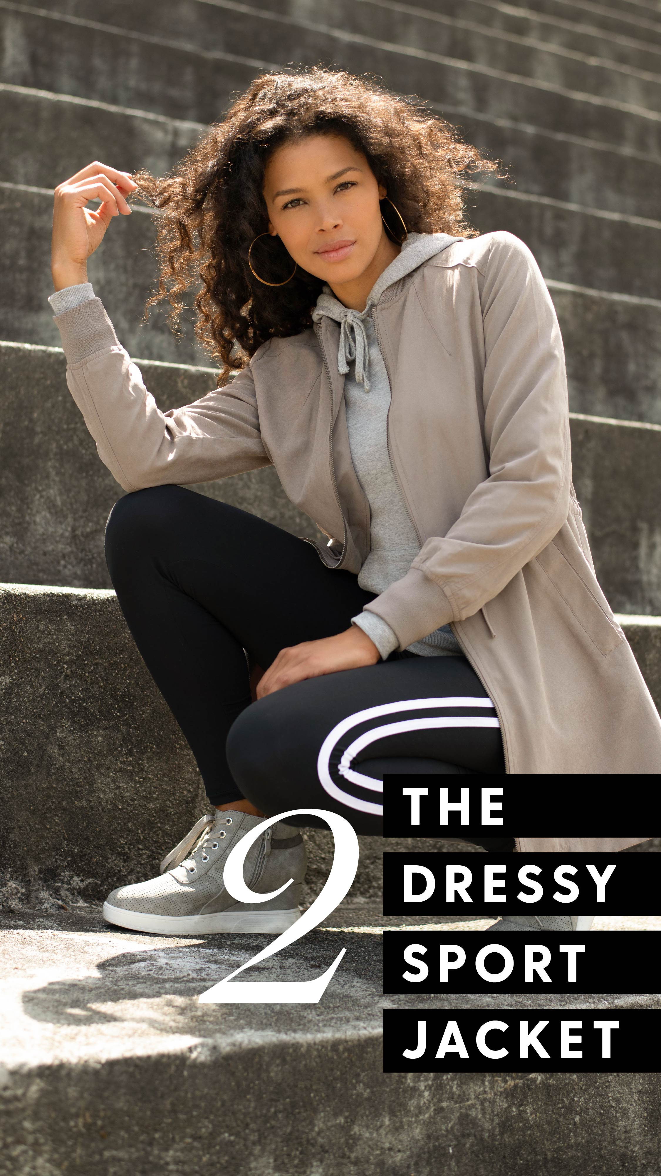 Style 2 - The dressy sporty jacket. Picture of women wearing a light grey/tan jacket layered with a grey hoodie.
